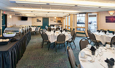 tables and chairs are well orderly place in the park point marina inn's meeting & banquet rooms