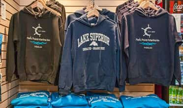 hoodies hanging in the Water's Edge Mercantile and Gift Shop Located at the Resort