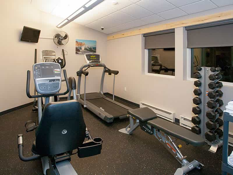 24 Hour Fitness Center has fitness treadmills, elliptical machine, free weights and a bench