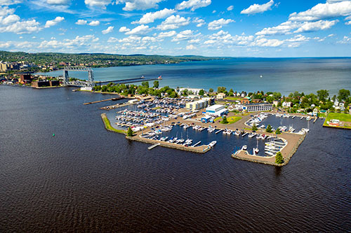 the overlook of Park Point Marina Inn and its shore full of pleasure boats taking from the sky